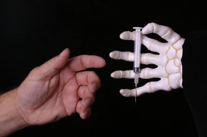 Needle and skeleton hand