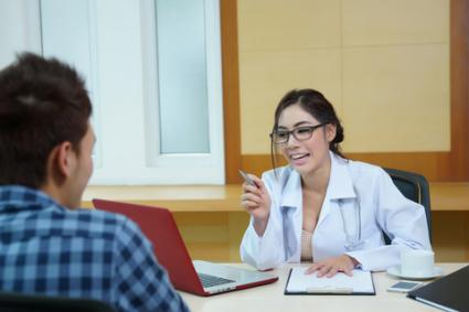 Happy doctor talking to patient; © Pixs4u | Dreamstime.com