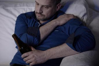 Man holding painful shoulder