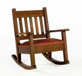 1930s platform rocker with swan fashioned arms | Instappraisal