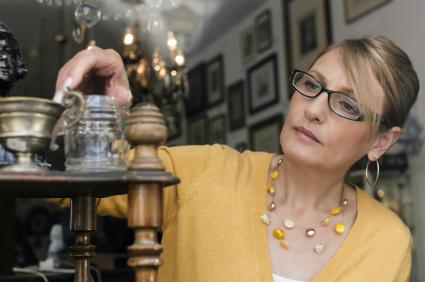 woman looking at antiques