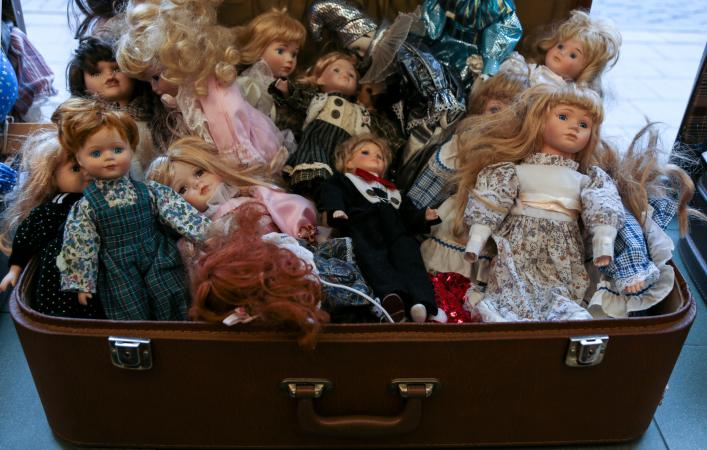 Suitcase full of old porcelain dolls