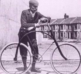 Old man with bicycle photo