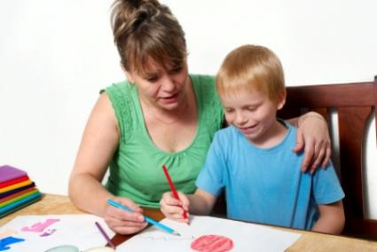 Mother and son using worksheets