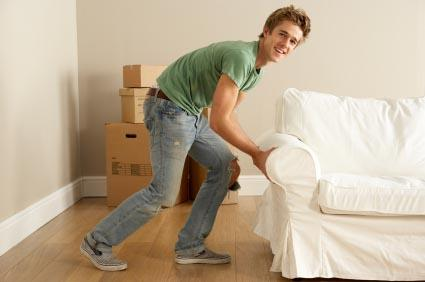 Young man moving into new apartment