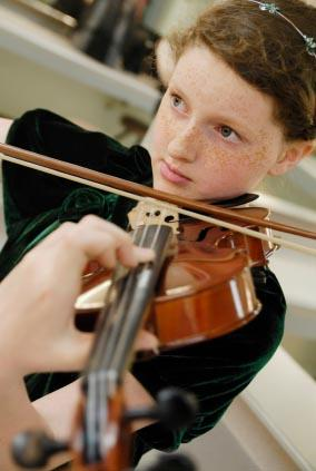 Autistic girl playing the violin