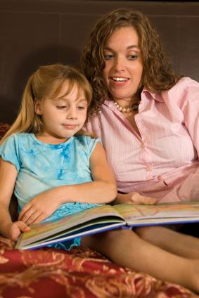 Mother working on reading with her autistic child