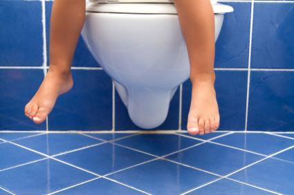 child on toilet