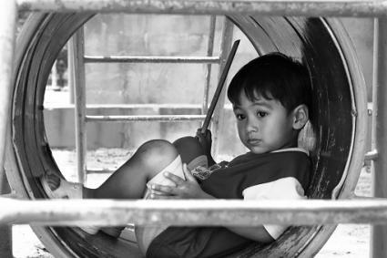 boy alone on playground