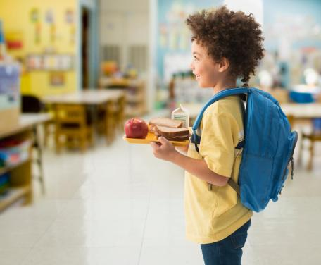 boy having lunch at school