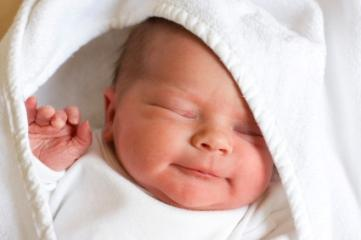 newborn baby in white blanket