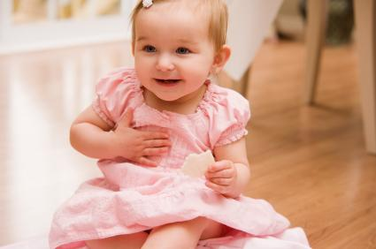 Baby girl in pink dress.