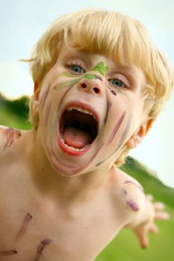 Crazy child with painted face