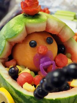 Baby shower fruit salad inside watermelon shell