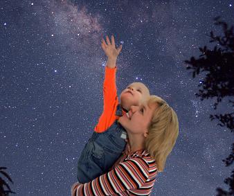 Mom and baby looking at stars