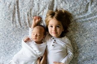baby and older sibling