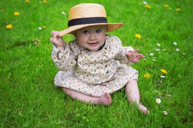 baby in daisies