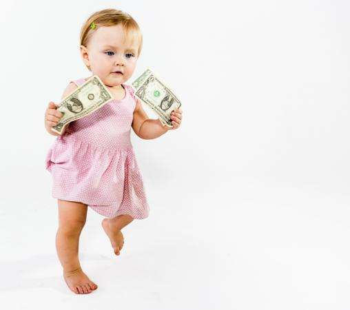 Baby girl running with dollar bills