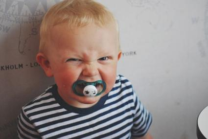 baby clenching pacifier