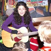 Meredith playing guitar