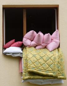 bed linens airing at window