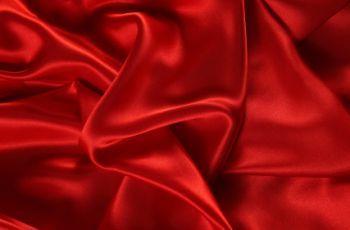 Red satin sheets for elegant bedding.