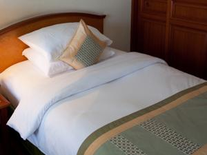 Neatly made bed turned down sheets