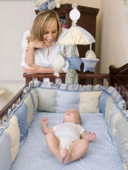 Mother watching son in crib