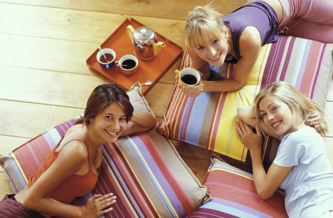 group of girls on floor pillows