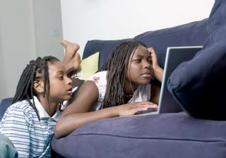 Young girls using a laptop