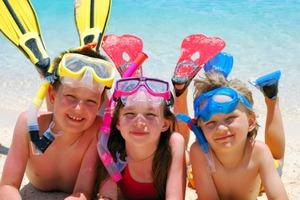 Kids on beach with snorkel gear