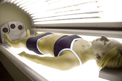 Woman on tanning bed