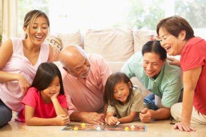 Family playing a board game