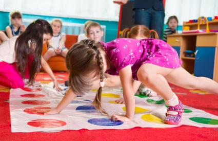 Toddlers playing Twister