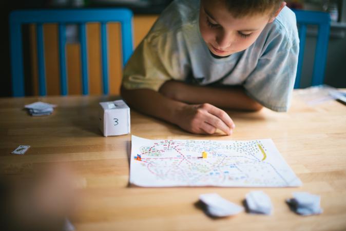 boy playing boardgame