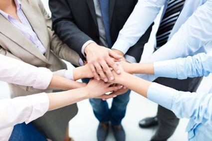 hands-in businesspeople