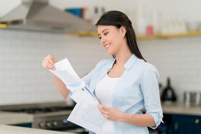 Woman reading direct mail letter