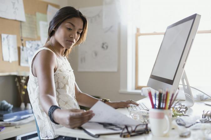 Female artist working on computer