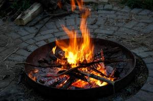A fire pit can be the centerpiece of your camp, providing food, warmth, and good times.