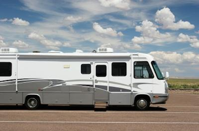 Recreational Vehicle With A White Rubber Roof