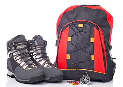 backpack and boots hiking gear