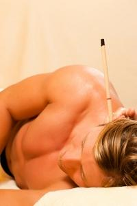 Man receiving ear candling