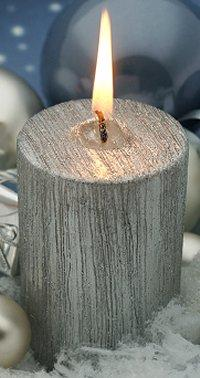 Silver candle with texture.