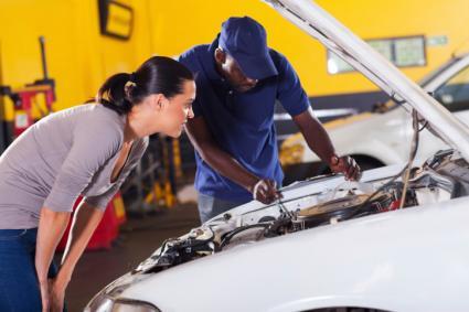 Woman and car repair man