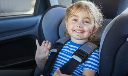 Little girl in car with messy face