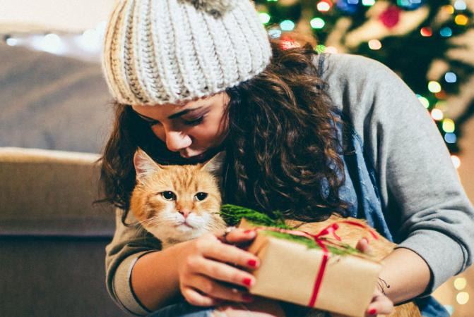 Girl with cat and gift