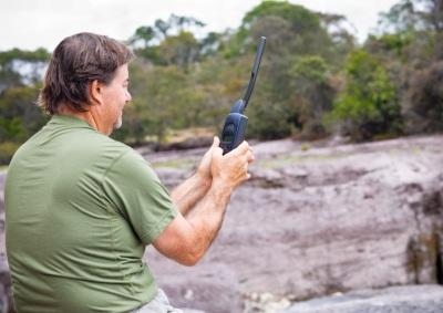 Man using satellite phone