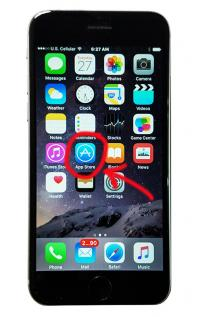 iPhone 6 showing app store with arrow