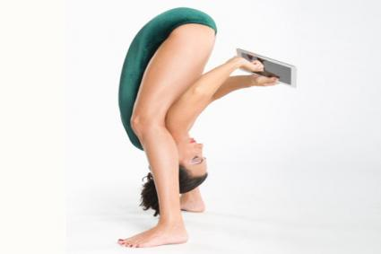 Woman using tablet while exercising