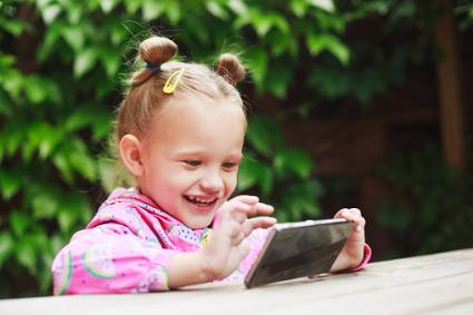 Toddler girl using a smart phone